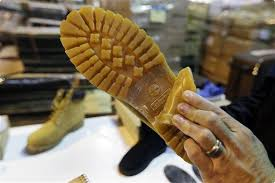 Stephen Long, US Customs and Border Protection deputy chief officer, shows how a Timberland brand on a counterfeit boot is hidden